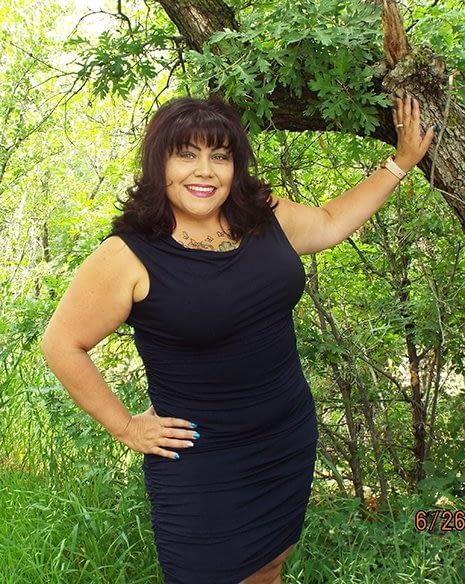 Debbie Blanc leaning on a tree